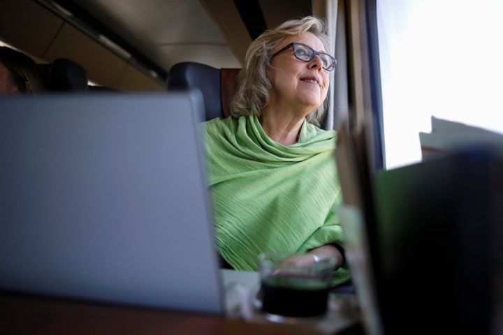 Green Party Leader Elizabeth May looks at the scenery while travelling by train for an election campaign visit in Montreal on Oct. 8, 2019.