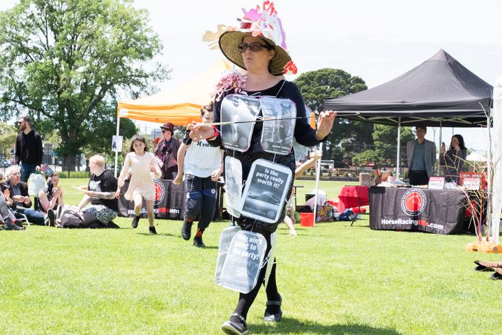 A protester wearing placards over her dress to take a stand.