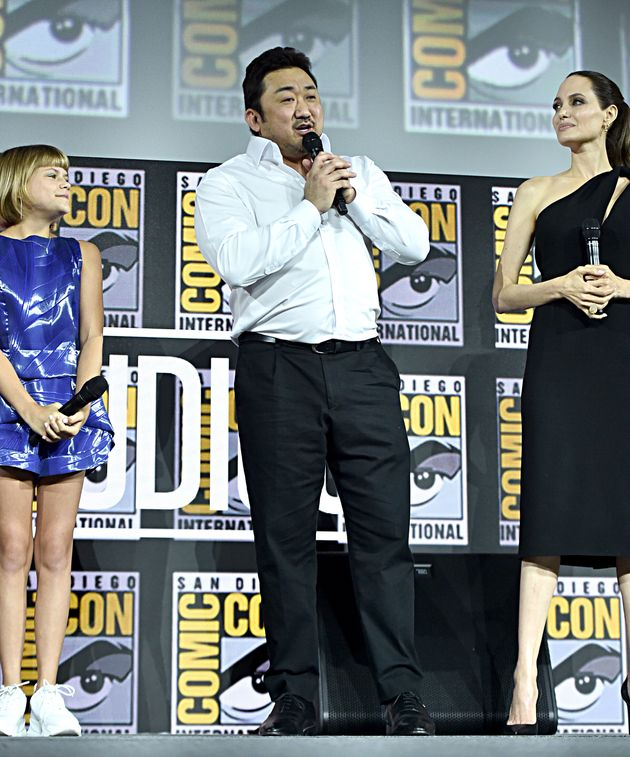 SAN DIEGO, CALIFORNIA - JULY 20: (L-R) Lia McHugh, Don Lee and Angelina Jolie of Marvel Studios' 'The...