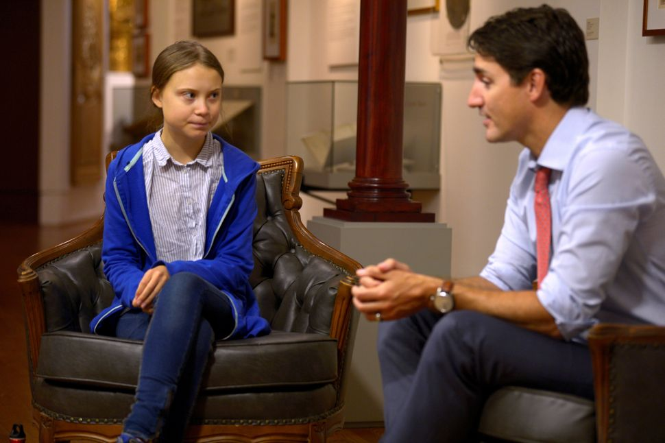 Justin Trudeau greets Swedish climate change teen activist Greta Thunberg before a march in Montreal...