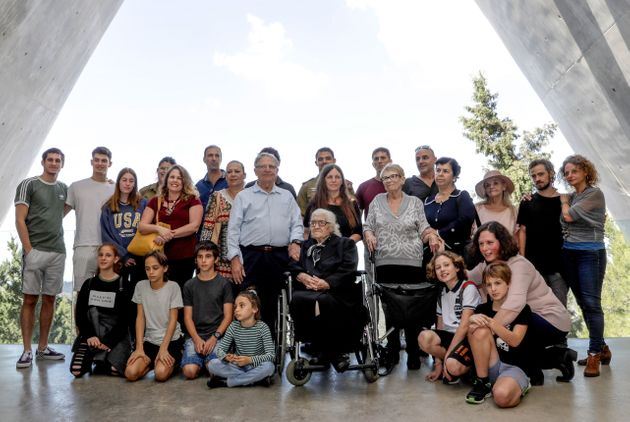 Greek World War II rescuer Melpomeni Dina (C) poses for a group photo with holocaust survivors Yossi...