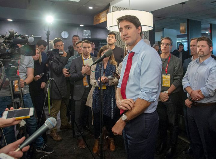 Liberal Leader Justin Trudeau speaks to reporters while campaigning on Oct. 4, 2019 in Quebec City.