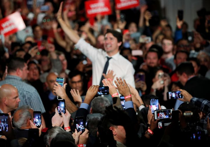 Justin Trudeau waves at a rally in Milton, Ont. on Oct. 19, 2019.