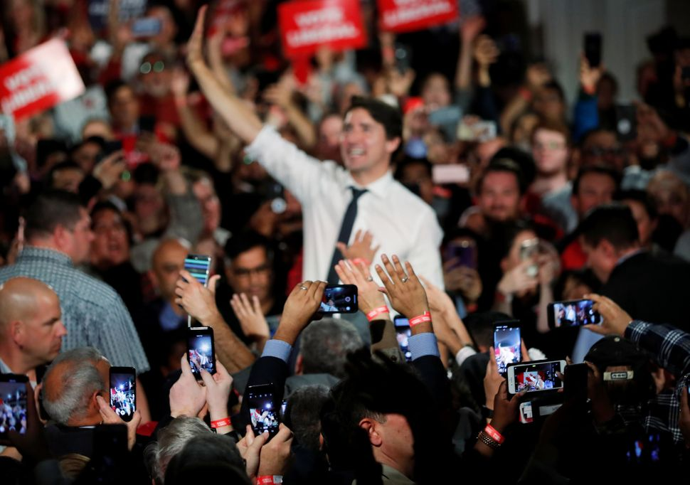 Justin Trudeau waves at a rally in Milton, Ont. on Oct. 19,