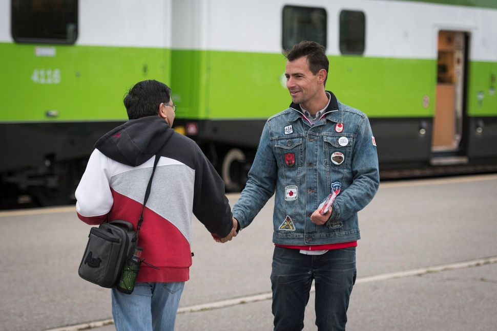 Liberal candidate Adam van Koeverden campaigns at the Milton GO Transit station on Oct. 17,