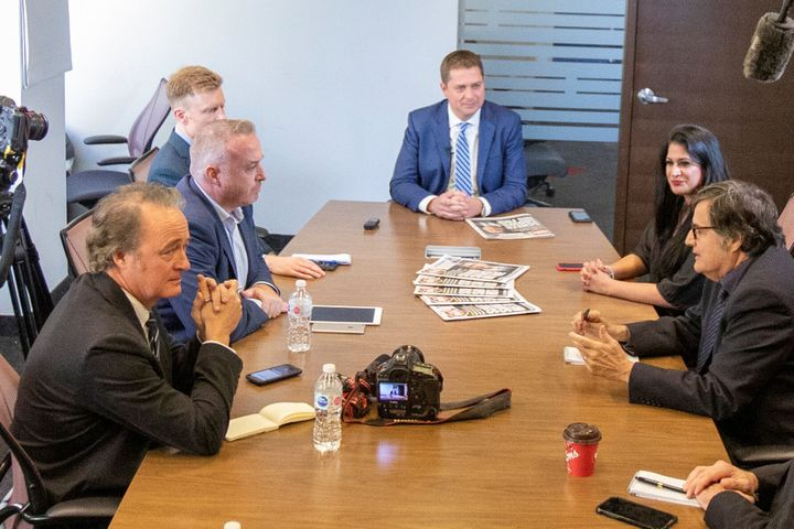 Warren Kinsella, front left, and the editorial board of the Toronto Sun meet with Conservative Leader Andrew Scheer, centre, in Toronto on Oct. 8, 2019.