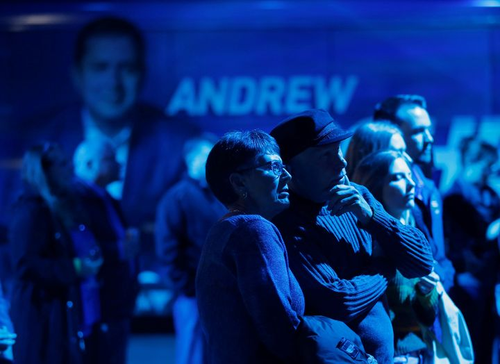 Conservative supporters watch the election results come in at Andrew Scheer's campaign headquarters in Regina on Oct. 21, 2019.