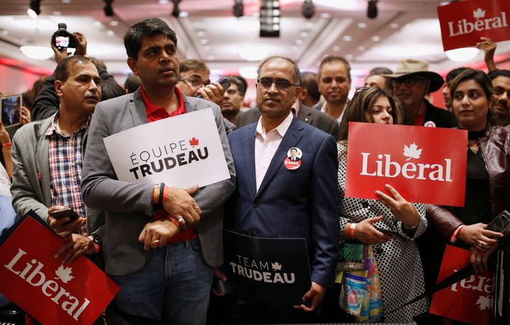 Liberal supporters wait for Justin Trudeau to attend a rally in Mississauga, Ont. on Oct. 12, 2019.
