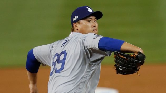 ASSOCIATED PRESS - Los Angeles Dodgers starting pitcher Hyun-Jin Ryu throws to a Washington Nationals...