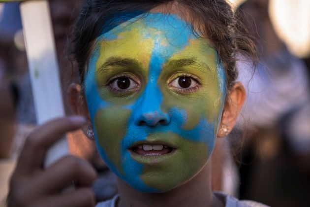 A young girl taking part in the climate strike in Madrid, Spain – one of the many climate strikes...