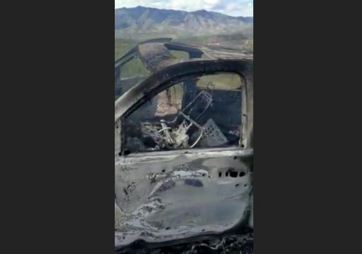 The burnt wreckage of a vehicle transporting a Mormon family living near the border with the U.S. is seen, after the family w