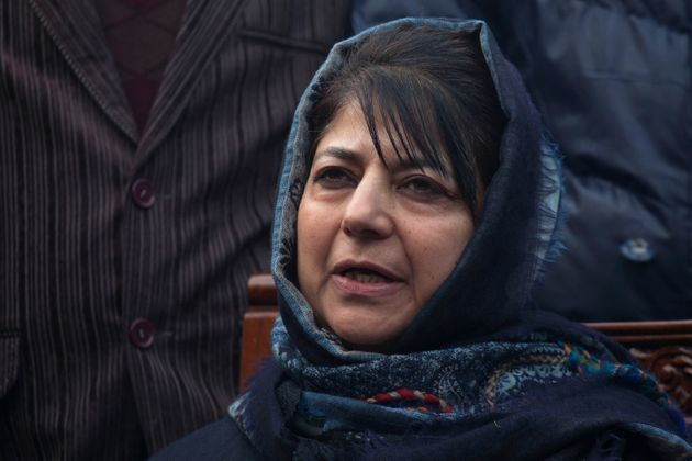 PDP leader Mehbooba Mufti addresses the media at her residence in Srinagar, India, Tuesday, Dec. 23,