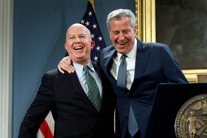 New York City Police Commissioner James O'Neill, left, is embraced by New York Mayor Bill de Blasio at New York's City Hall,