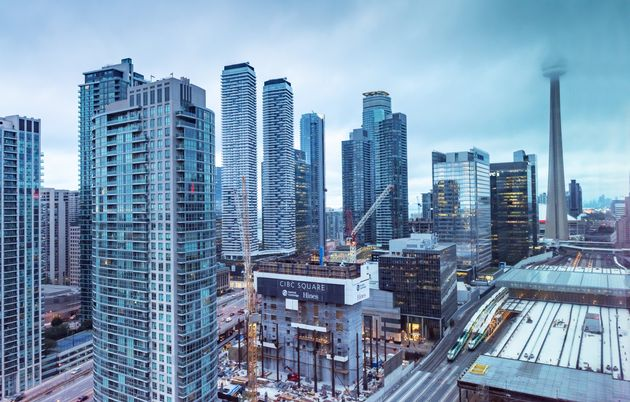Condo towers flank the construction site of CIBC Square in downtown Toronto, Sept. 24,