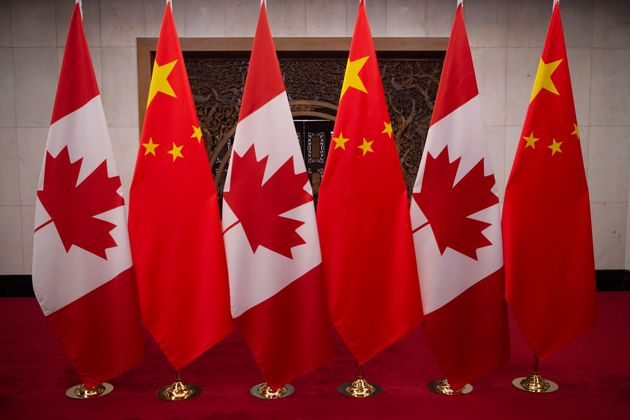This picture taken on Dec. 5, 2017, shows the flags of Canada and China before a meeting between global...