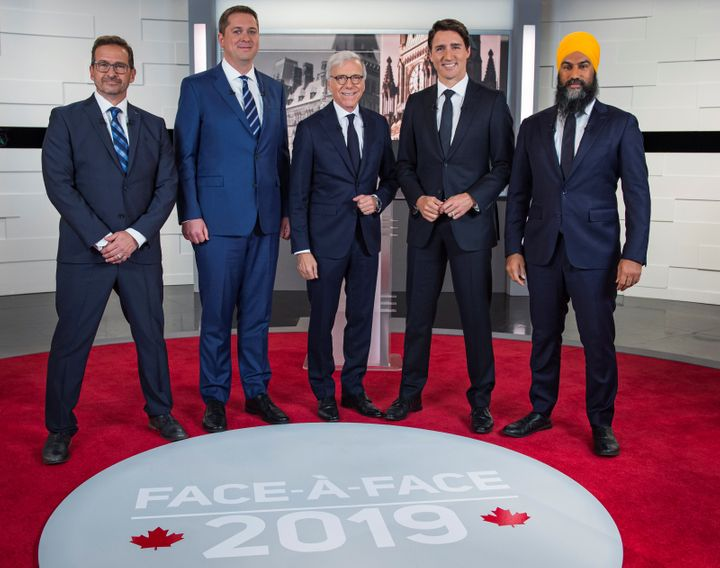 From left to right: Bloc Quebecois Leader Yves-François Blanchet, Conservative Leader Andrew Scheer, TVA network host Pierre Bruneau, Liberal Leader Justin Trudeau and NDP Leader Jagmeet Singh pose before the TVA debate in Montreal on Oct. 2, 2019.