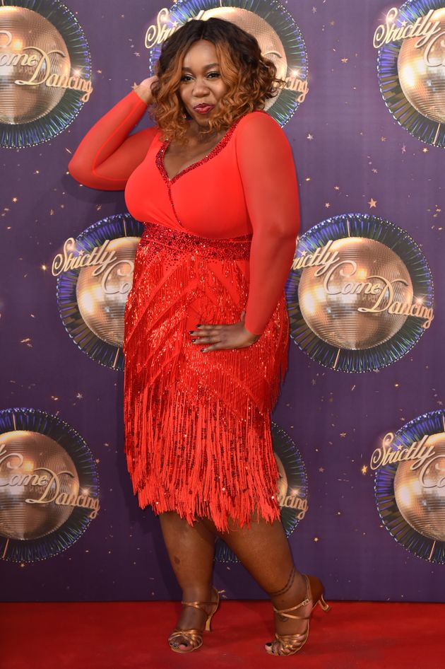 Chizzy Akudolu strikes a pose on the Strictly red
