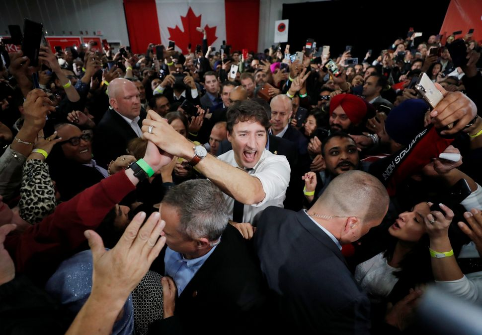 Liberal Leader Justin Trudeau greets crowds at a campaign rally in Calgary on Oct. 19,