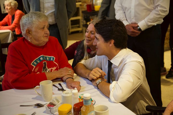 Justin Trudeau chats with Pat Millington, who wore red for the occasion. The Liberal leader was visiting the Emerald Retirement Residence in Niagara Falls, Ont.
