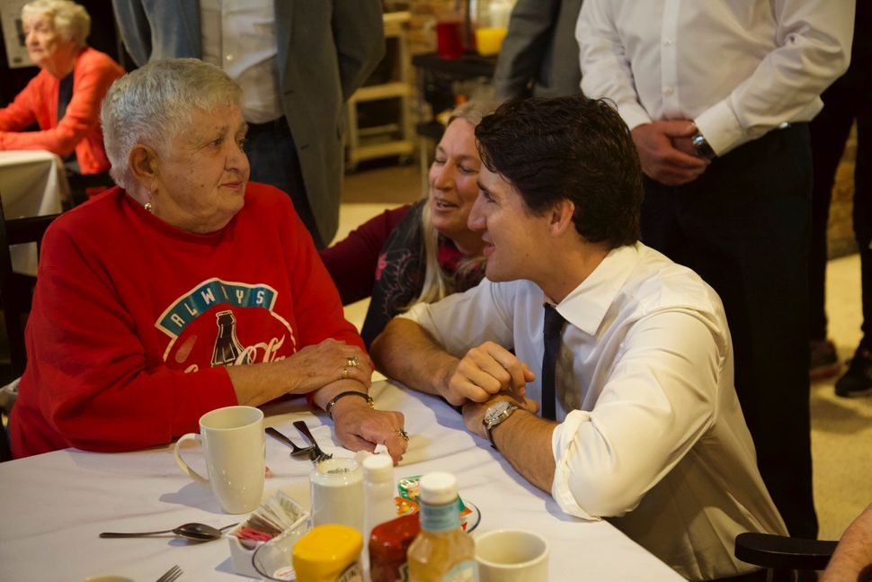Justin Trudeau chats with Pat Millington, who wore red for the occasion. The Liberal leader was visiting...