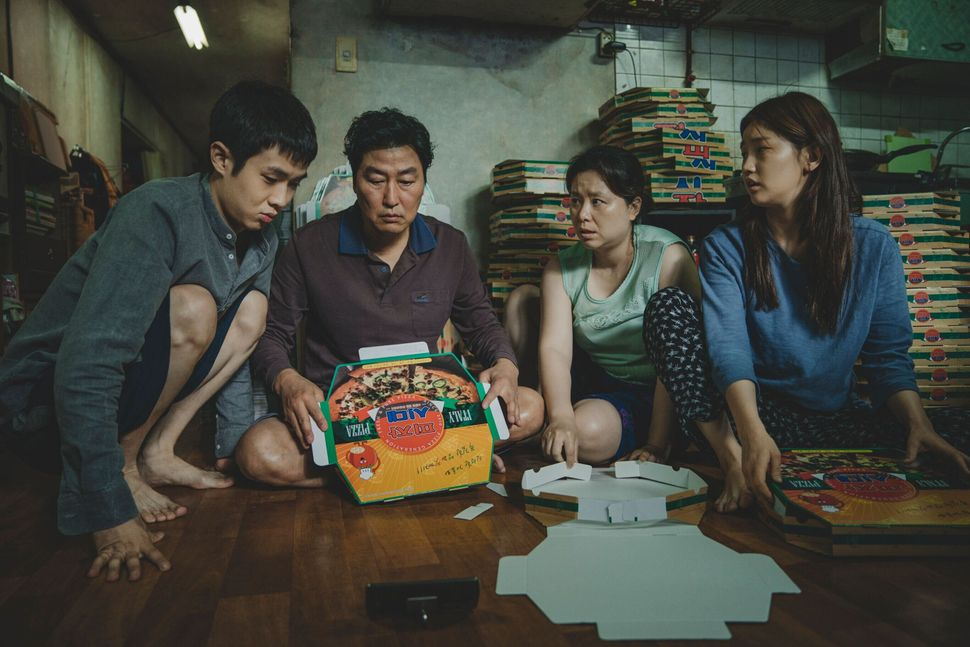 "Choi Woo-shik, Song Kang-ho, Jang Hye-jin and Park So-dam in ""Parasite."""