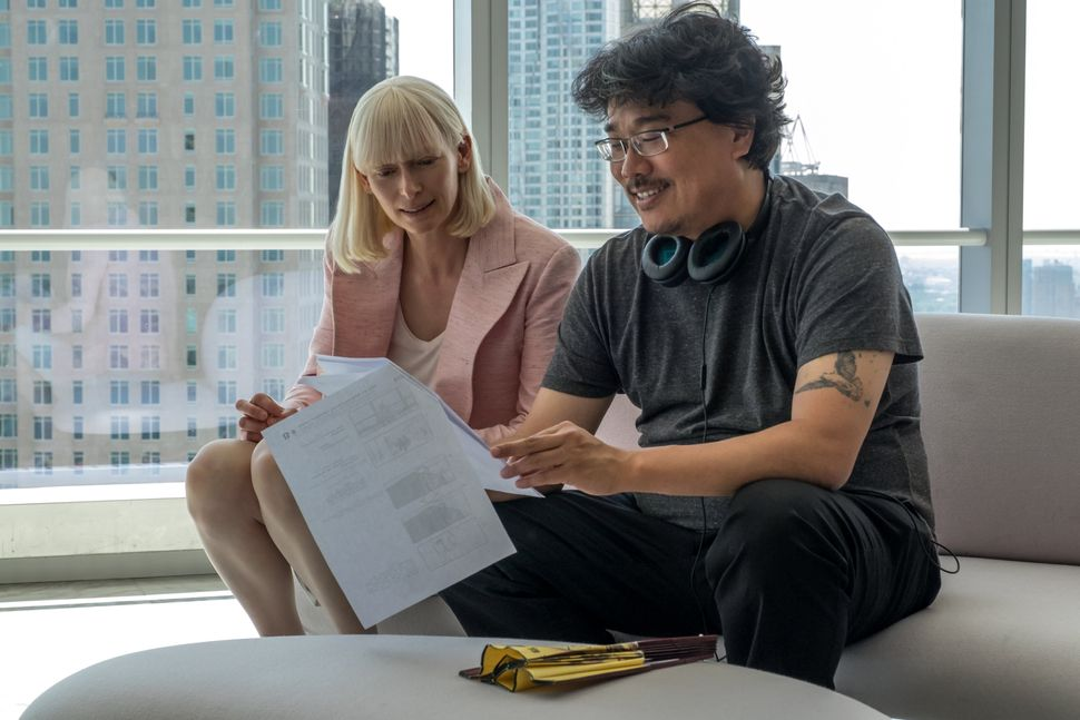 "Tilda Swinton and Bong Joon-ho on the set of ""Okja."""
