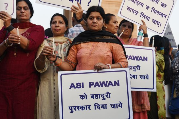 Families of Delhi Police personnel protest against attacks on the cops by lawyers, at India Gate on November...