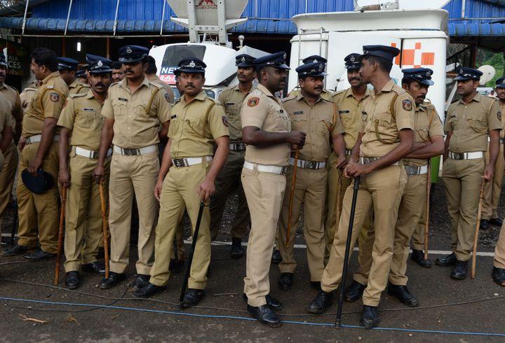 Kerala policement stand guard in Nilackal.