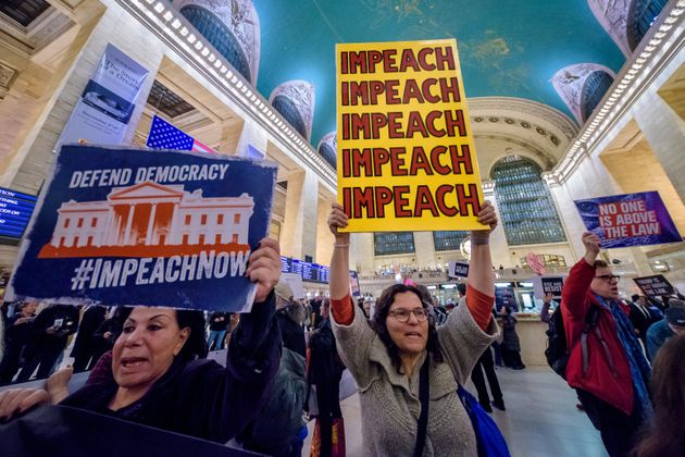 MANHATTAN, NEW YORK, UNITED STATES - 2019/11/05: Protester holding a sign reading IMPEACH. On the heels...