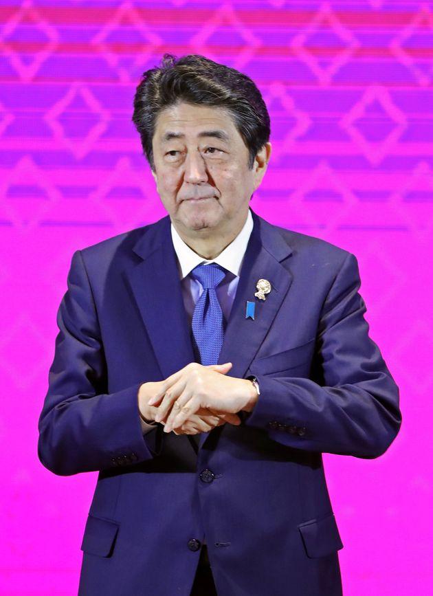 Japan's Prime Minister Shinzo Abe attends the ASEAN-Japan Summit in Bangkok, Thailand, November 4, 2019....