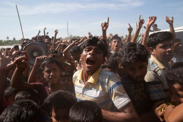 Rohingya refugees shout slogans during a protest against the repatriation process at Unchiprang refugee...