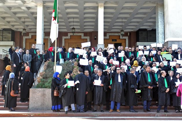 Algerian judges and prosecutors lift placards during a protest in front of the judicial council in the...