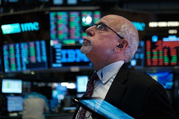 NEW YORK, NEW YORK - SEPTEMBER 16: Trader Peter Tuchman works on the floor of the New York Stock Exchange...