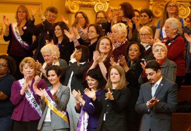 Democratic state senators applaud a speech along with other ERA supporters in the gallery of the the...