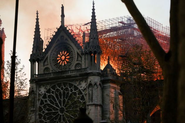 Flames and smoke billow from the roof at Notre-Dame Cathedral in Paris on April 15,