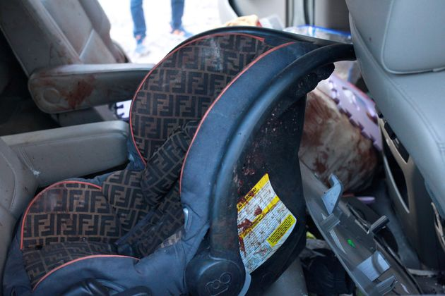 A car seat stained in blood is pictured in a bullet-riddled vehicle belonging to one of the Mexican-American...
