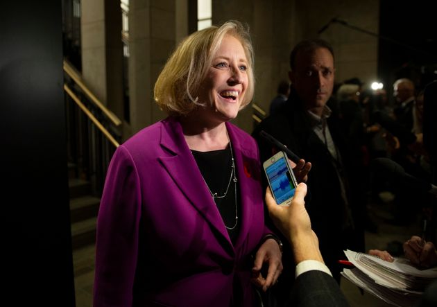 Former Conservative MP Lisa Raitt, who lost her seat in the election, speaks to reporters before attending...