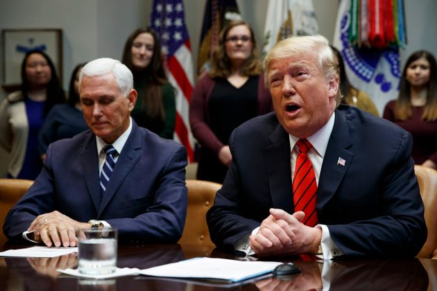 Vice President Mike Pence listens as President Donald Trump speaks from the Roosevelt Room of the White...