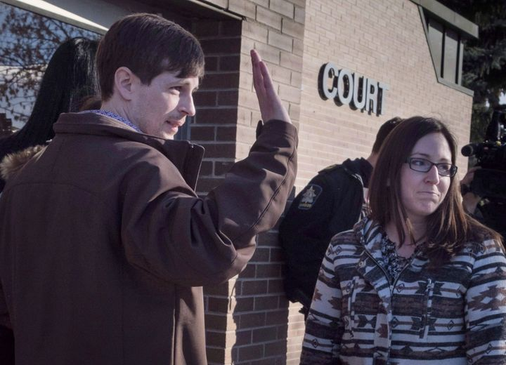 Edouard Maurice waves to supporters outside court with his wife Jessica in Okotoks, Alta. on Mar. 9, 2018.