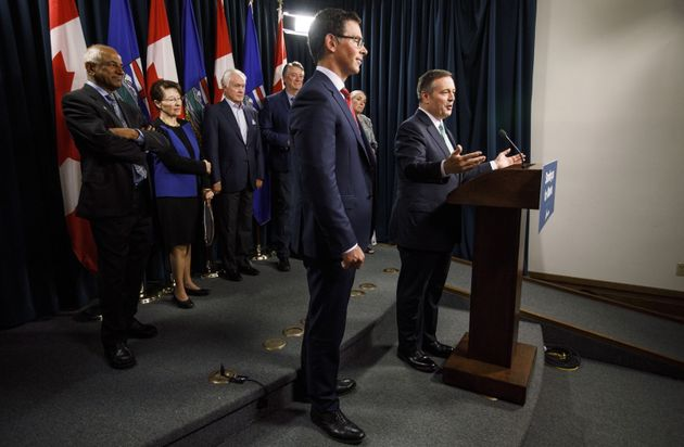 Jason Kenney and Doug Schweitzer, Minister of Justice and Solicitor General, speak in Edmonton on June...
