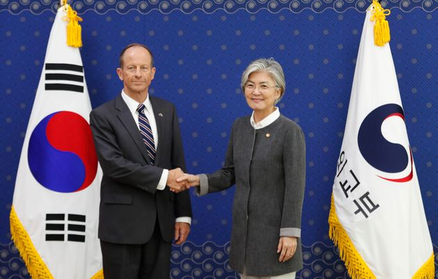 South Korean Foreign Minister Kang Kyung-wha (R) shakes hands with David Stilwell, US Assistant Secretary...