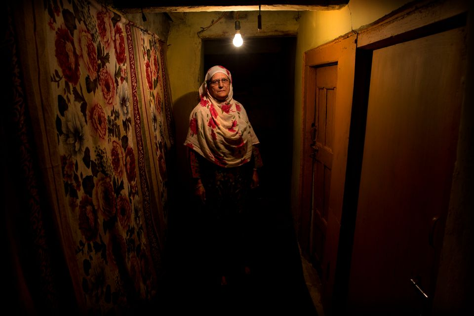 In this Sept. 25, 2019, photo, Ateeqa Begum, mother of a 22-year-old Kashmiri detainee Fasil Aslam Mir,...