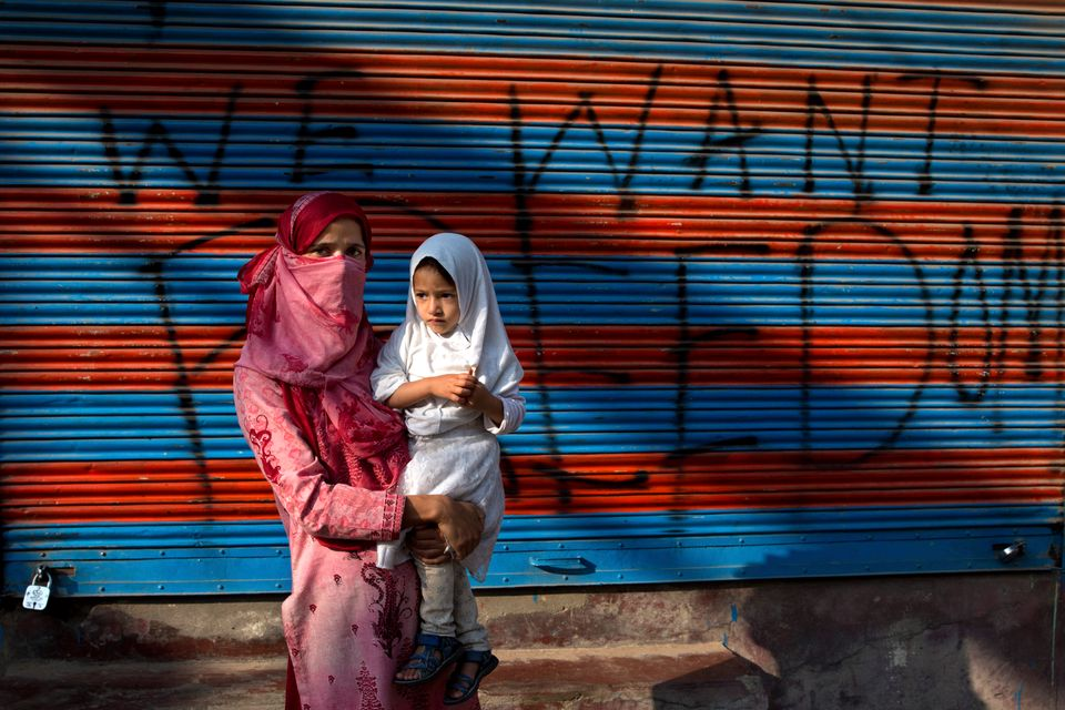 In this Sept. 27, 2019, photo, a Kashmiri woman protestor Jawahira Banoo carries her 3-year-old daughter...