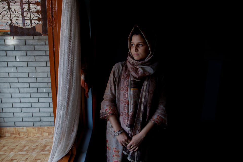 In this Oct. 14, 2019, photo, newly married Kulsuma Rameez, 24, stands for photographs inside her home...
