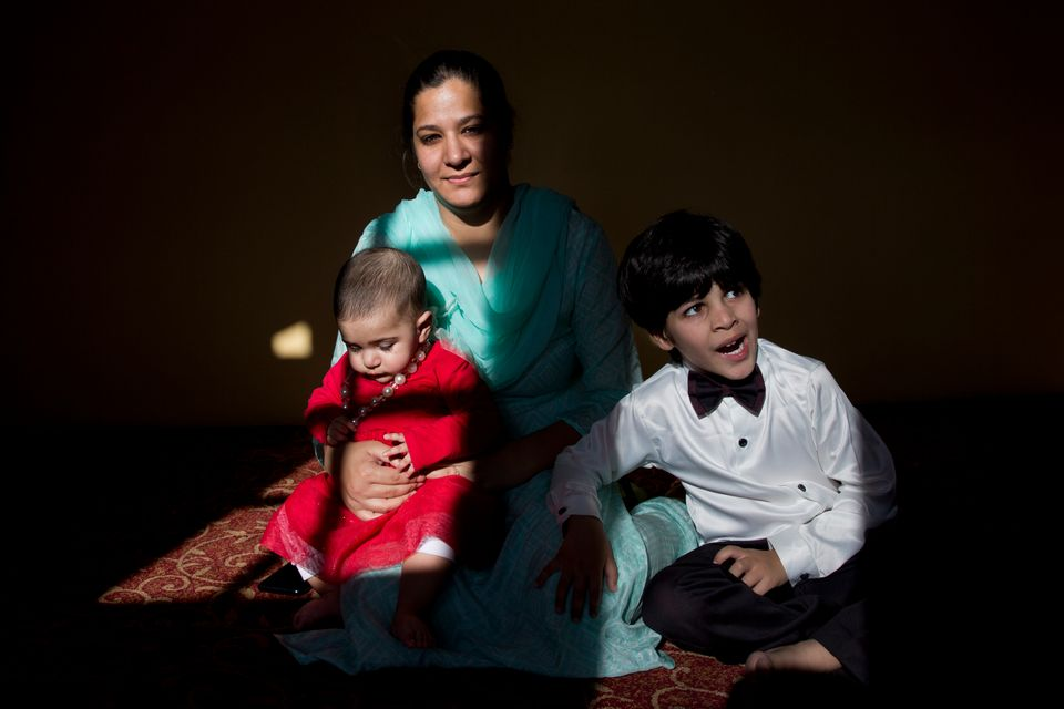 In this Oct. 14, 2019, photo, a Kashmiri-born Australian Sumaya Rather sits with her eight-month-old...
