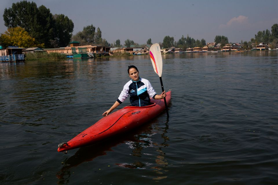 In this Friday, Oct. 25, 2019, photo, a Kashmiri kayaker Mehak Peer, 26, sits for a photograph during...