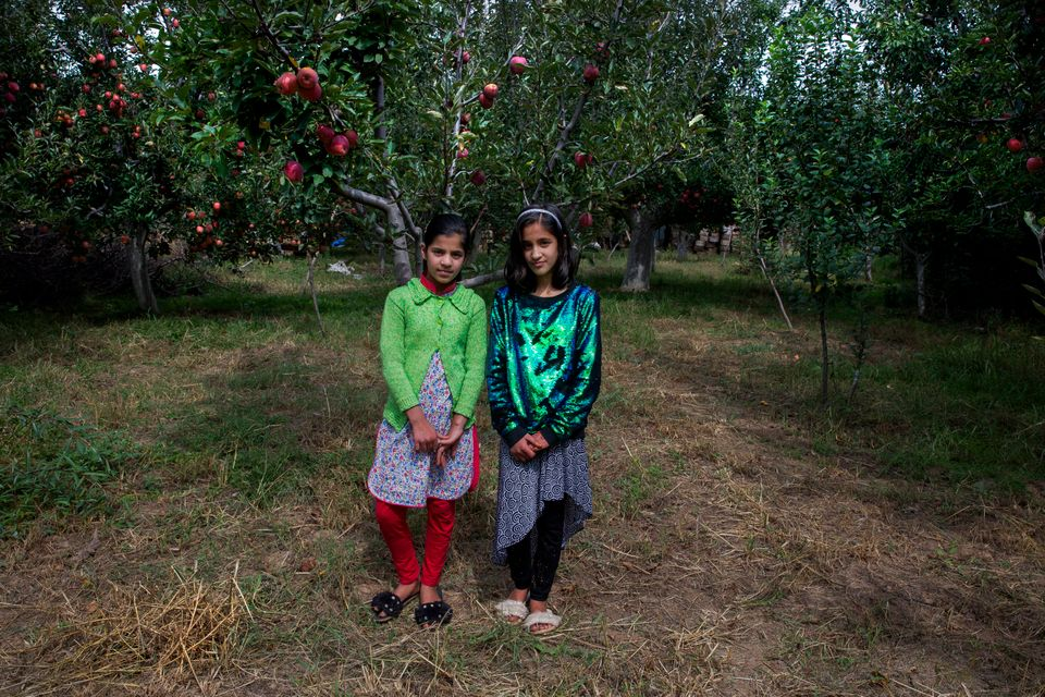 In this Oct. 6, 2019, photo, twin sisters Tabeer Shafi Bhat, right, and Taseer Shafi Bhat stand for photographs...