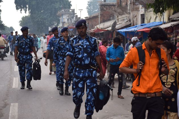 Rapid Action Force (RPF) and Uttar Pradesh Police personnel patrol a street in Ayodhya on November 06,