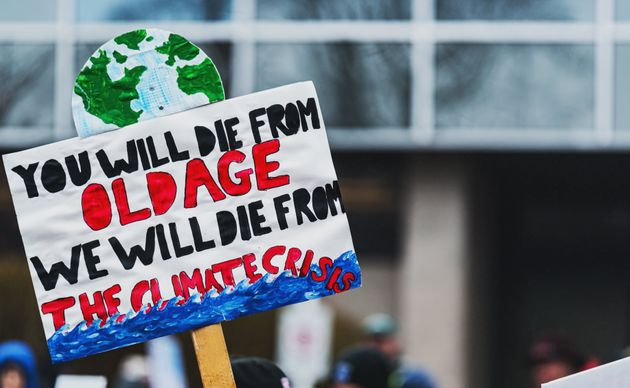 Climate change protestors hold their placards