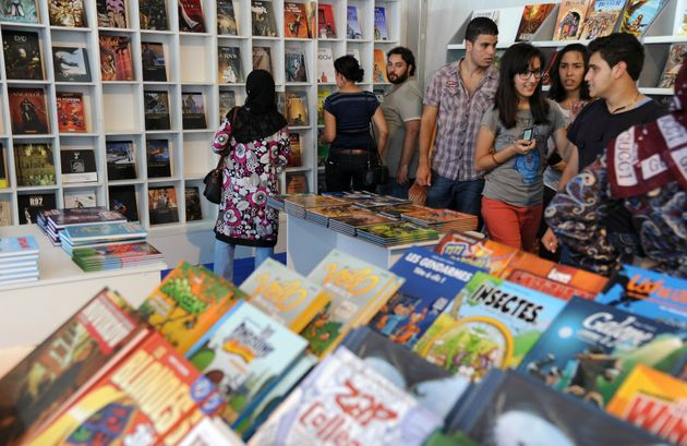 Visitors look at comic strip books on the opening day of the 5th International Festival of Comics of...